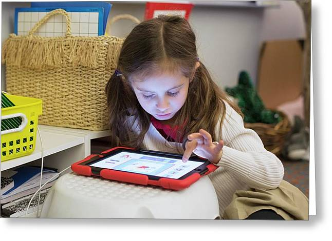 Primary School Girl Using Tablet Greeting Card