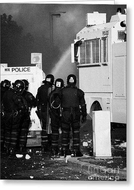 Psni Riot Officers Behind Armoured Land Rover And Water Cannon On Crumlin Road At Ardoyne Shops Belf Greeting Card by Joe Fox