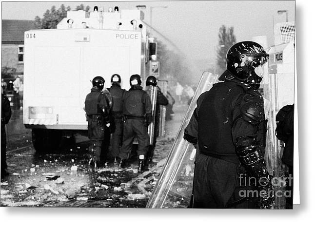 Psni Riot Officers Behind Water Canon During Rioting On Crumlin Road At Ardoyne Shops Belfast 12th J Greeting Card