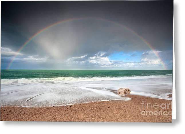 rainbow over Atlantic ocean waves on coast Greeting Card