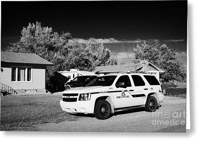 rcmp police patrol car parked outside a small town house in rural Saskatchewan Canada Greeting Card by Joe Fox
