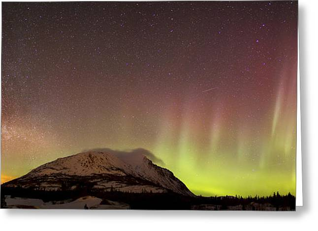 Red Aurora Borealis And Milky Way Greeting Card by Joseph Bradley