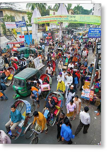 Rickshaws In Traffic On A Street Greeting Card by Michael Runkel