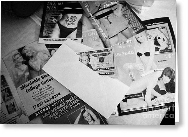 Selection Of Leaflets Advertising Girls Laid Out On A Hotel Bed With Us Dollars Cash In An Envelope  Greeting Card by Joe Fox