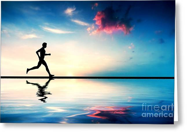 Silhouette Of Man Running At Sunset Greeting Card