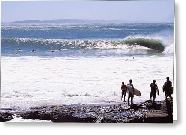 Silhouette Of Surfers Standing Greeting Card by Panoramic Images