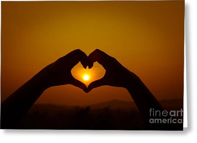 Greeting Card featuring the photograph Silhouettes Hand Heart Shaped by Tosporn Preede