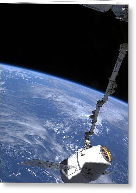 Spacex Dragon Capsule At The Iss Greeting Card by Science Photo Library