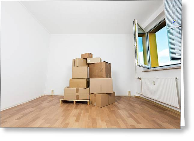 Stack Of Cardboard Boxes In An Empty Room Greeting Card