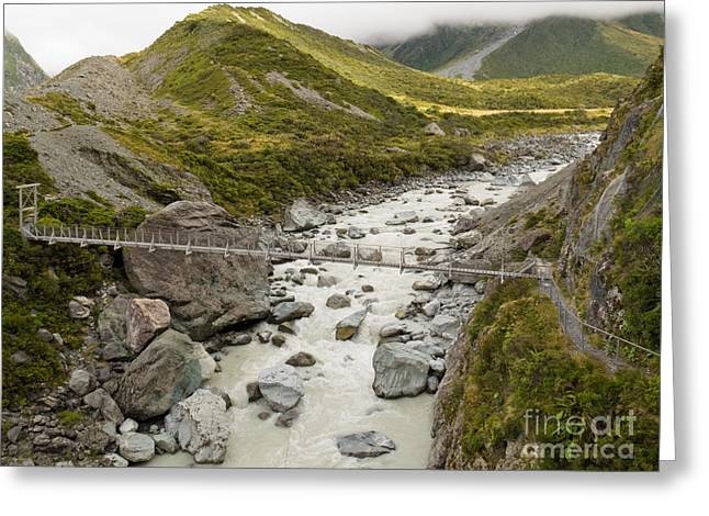 Swing Bridge Over Mountain River In New Zealand Greeting Card by Stephan Pietzko