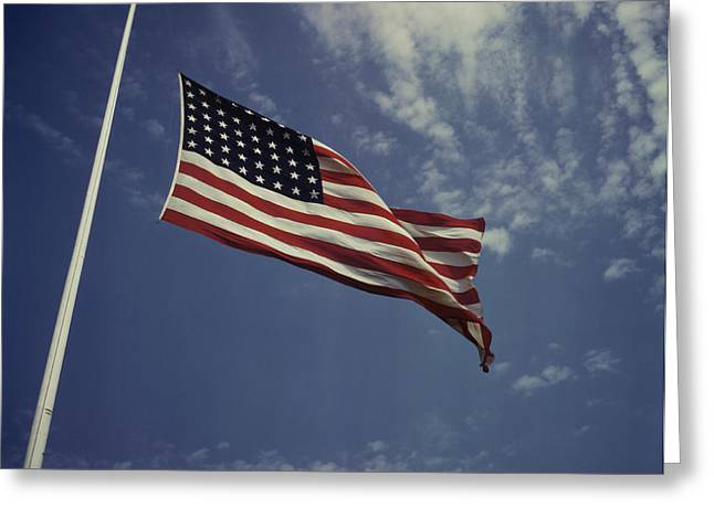 The American Flag Waving In The Wind Greeting Card by Stocktrek Images