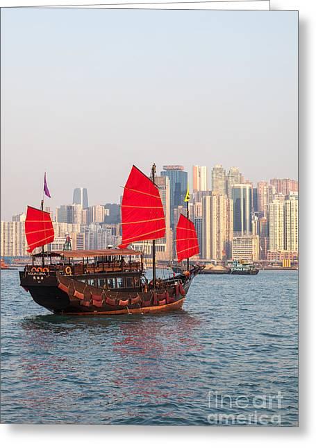 Traditional Junk Boat Sailing In Hong Kong Harbor Greeting Card by Matteo Colombo