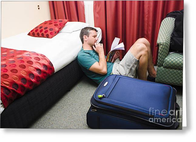 Travelling Man Holding Travel Itinerary Greeting Card