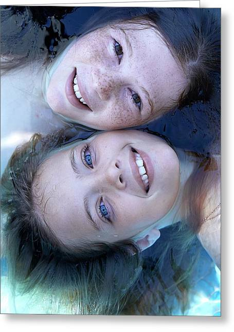 Two Girls Floating In Water Greeting Card by Ruth Jenkinson