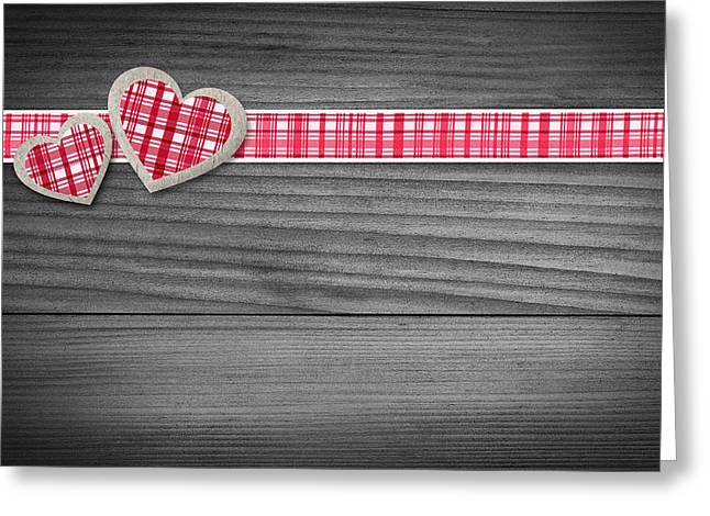 Two Hearts Laying On Wood  Greeting Card by Aged Pixel