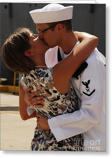 U.s. Navy Sailor Is Greeted By His Wife Greeting Card by Stocktrek Images