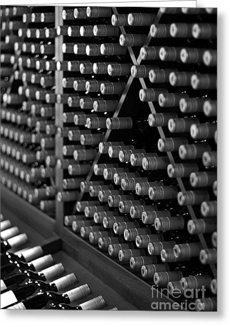 Wine Bottles On A Rack At A Winery Near The Vineyards Greeting Card