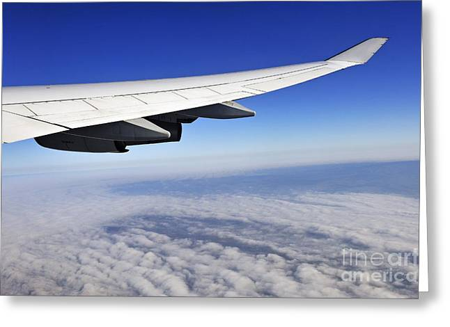 Wing Of Flying Airplane Above Clouds Greeting Card by Sami Sarkis