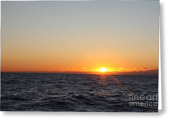 Winter Sunrise Over The Ocean Greeting Card by John Telfer