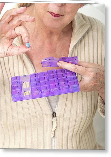 Woman Holding Pill And Pill Container Greeting Card by Lea Paterson