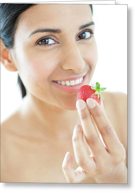 Woman Holding Strawberry Greeting Card by Ian Hooton