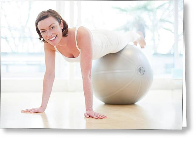 Woman On Exercise Ball Greeting Card