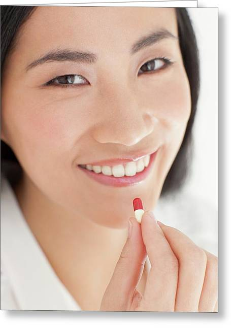 Woman Taking Tablet Greeting Card