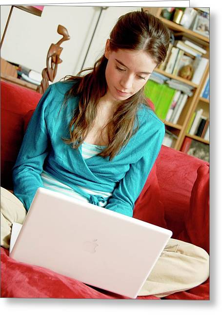Woman Using A Laptop Computer Greeting Card by Aj Photo/science Photo Library
