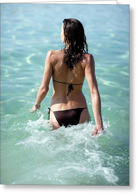 Woman Walking Into The Sea Greeting Card