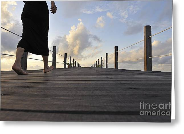 Woman Walking On Wooden Jetty At Sunrise Greeting Card by Sami Sarkis