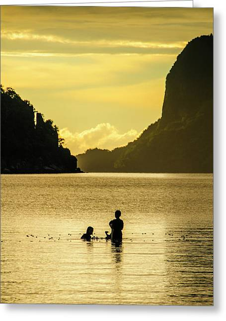 Young Boys Fishing At Sunset In The Bay Greeting Card by Michael Runkel
