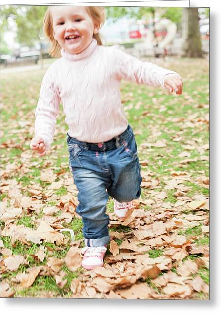 Young Girl Running In The Leaves Greeting Card by Ian Hooton