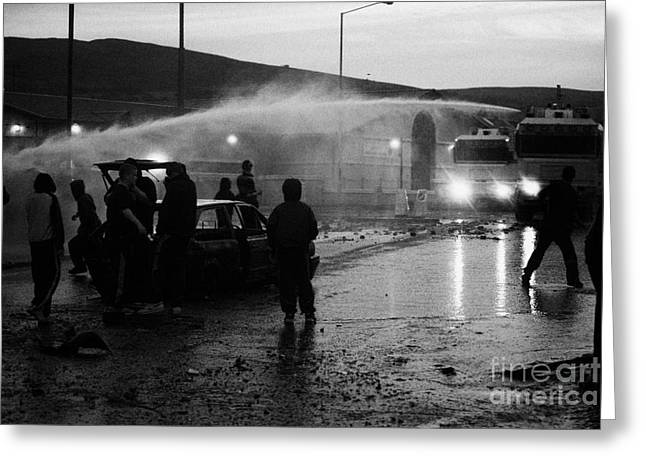 Youths Rioting With Burned Out Car Being Hit By Water Canon On Crumlin Road At Ardoyne Greeting Card by Joe Fox
