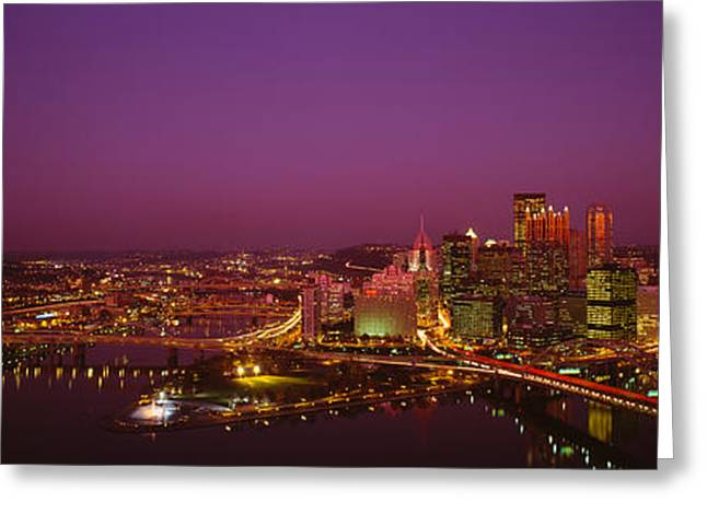 High Angle View Of Buildings Lit Greeting Card