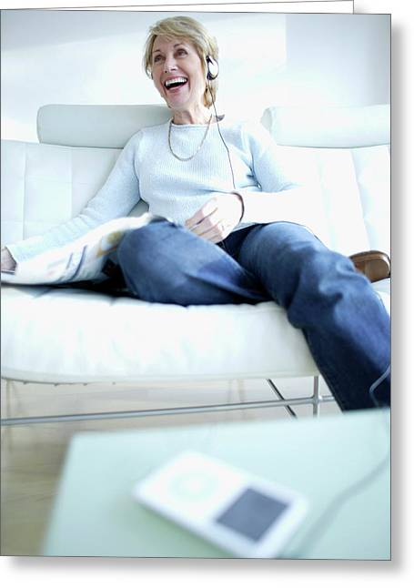 Woman Listening To Music Greeting Card by Ian Hooton/science Photo Library