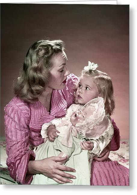 1940s Mother Sitting On Bed Holding Greeting Card