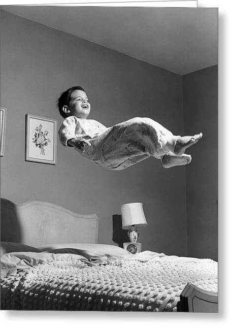 1950s Boy In Pajamas Elevated Above Bed Greeting Card