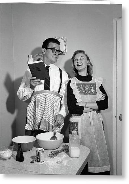 1950s Couple In Kitchen With Husband Greeting Card