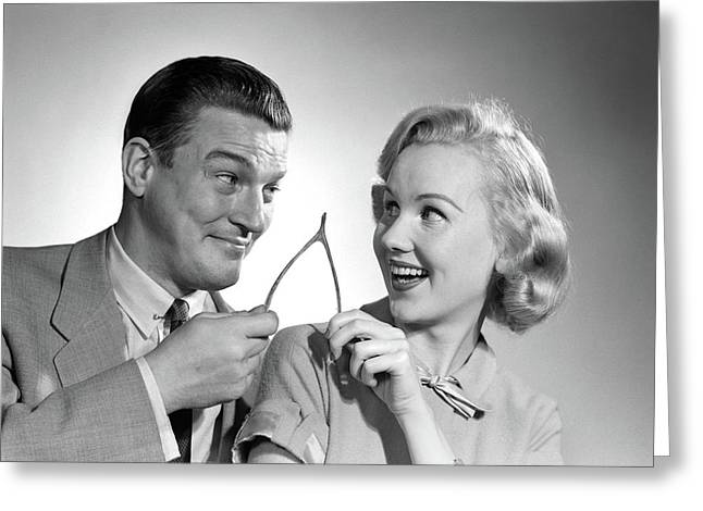 1950s Portrait Of Couple Holding Greeting Card