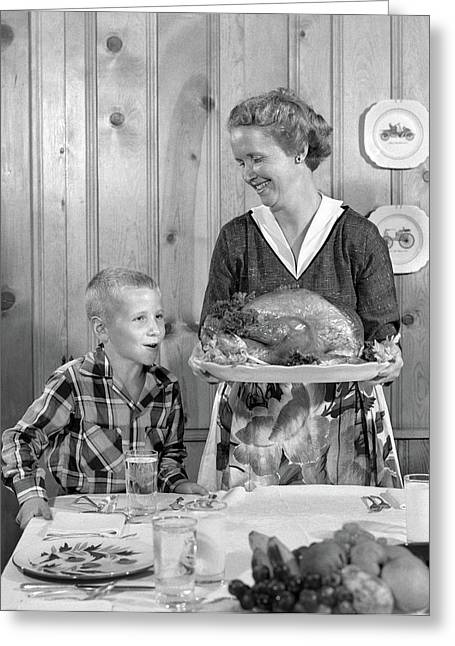 1950s Woman In Apron Putting Turkey Greeting Card
