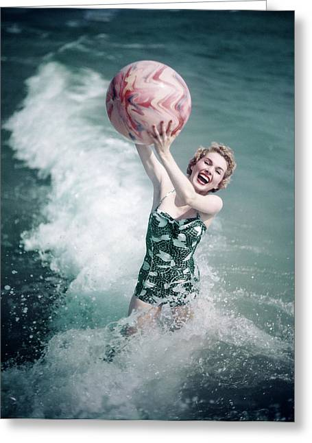 1950s Woman Jumping In Surf Holding Greeting Card