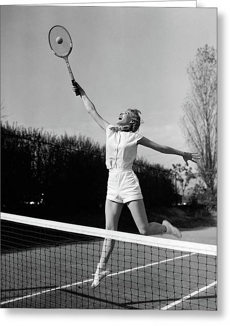 1950s Woman Jumping To Hit Tennis Ball Greeting Card
