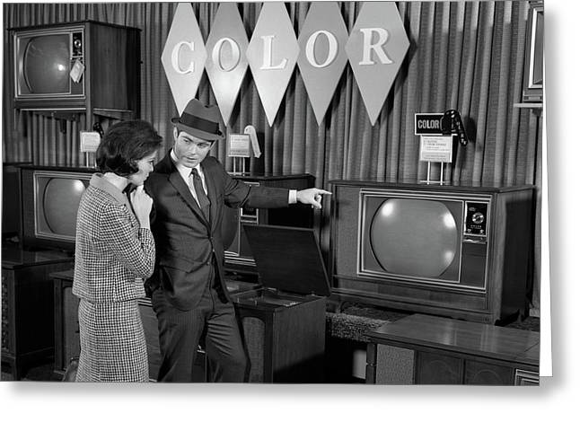1960s Couple Shopping For Color Tvs Greeting Card