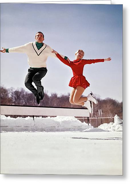 1960s Man And Woman Ice Skaters Jumping Greeting Card