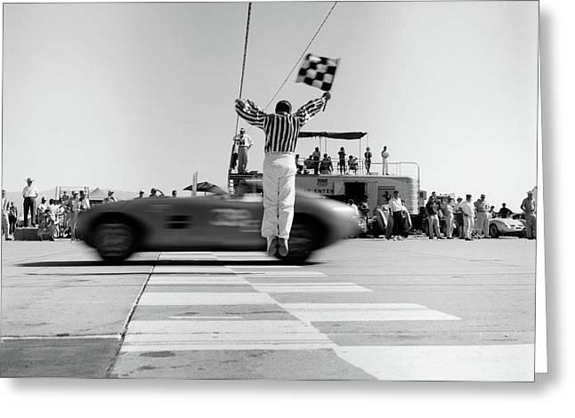 1960s Man Jumping Waving Checkered Flag Greeting Card