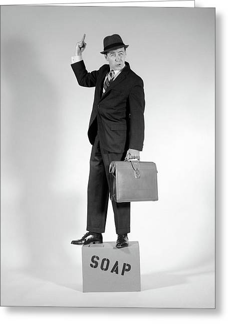 1960s Man Standing On Soap Box Holding Greeting Card