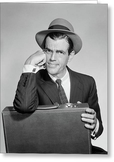 1960s Salesman Holding Briefcase In Lap Greeting Card