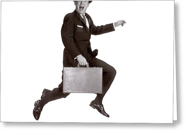 1960s Salesman Leaping In Air Holding Greeting Card