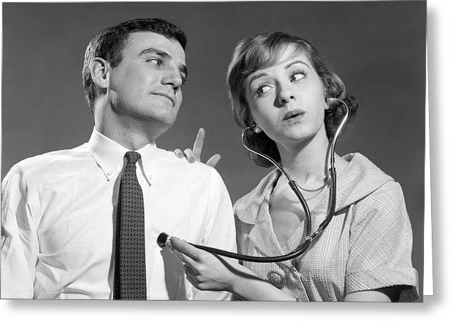 1960s Wife With Stethoscope On Husband Greeting Card