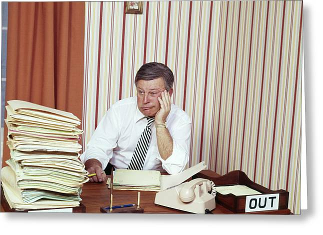 1970s Overwhelmed Businessman Sitting Greeting Card